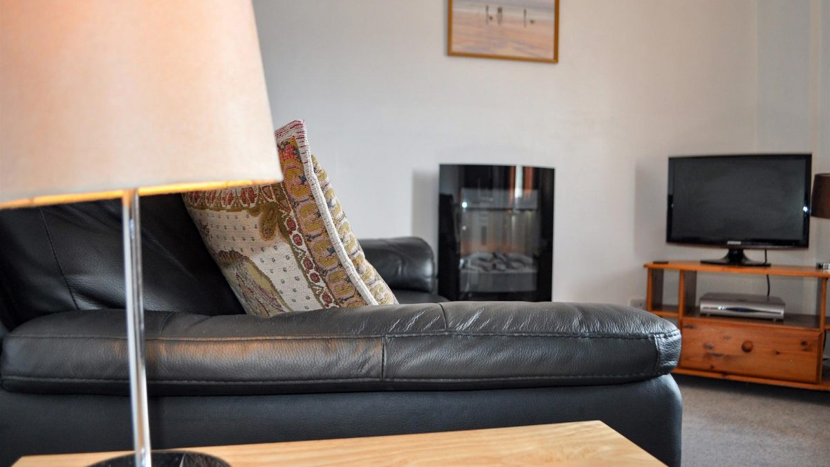 Cosy lounge in our Outer Hebridean 1 bedroom chalets at Cologin, near Oban