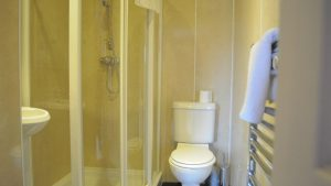 Ensuite shower room in Cologin Farmhouse