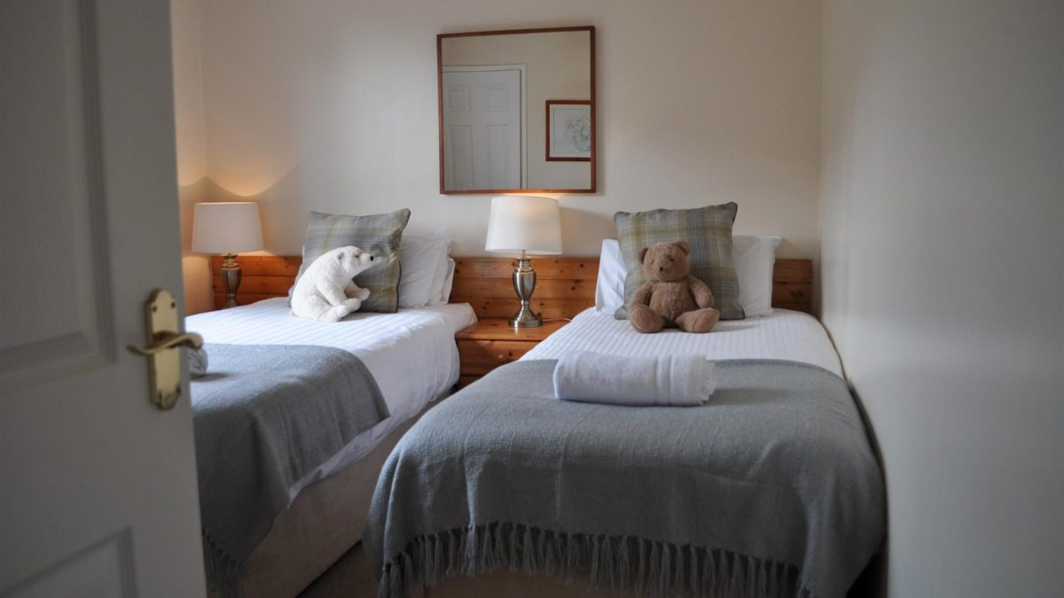 Cosy twin room in our Inner Hebridean self-catering lodges at Colgin, near Oban