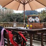 Picnics and wetsuits on the decking at Cologin Farmhouse