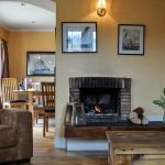 The lounge and dining area in Cologin Farmhouse, self-catering near Oban